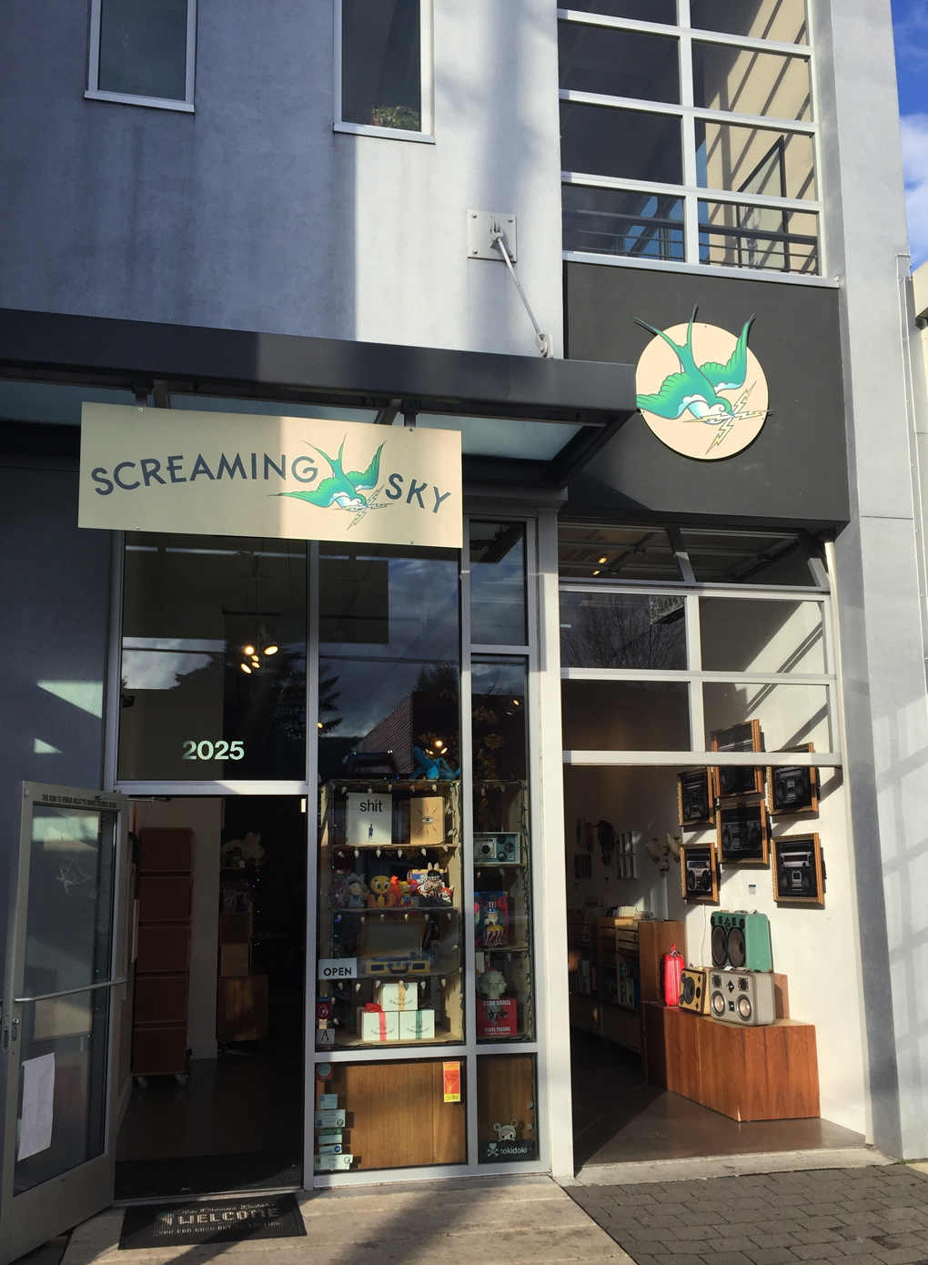 Screaming Sky storefront sign design
